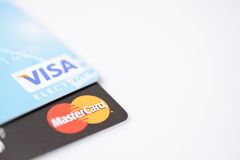 MINSK, BELARUS - February 22, 2017. Visa and Mastercard logos on credit cards on white. Royalty Free Stock Photos
