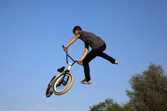 The guy performs a jump on a stunt bike stock photos