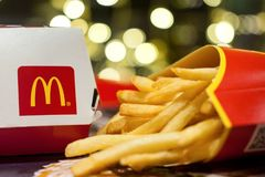 Minsk, Belarus, January 3, 2018: Big Mac Box with McDonald`s logo and French fries in McDonald`s Restaurant. Big Mac Box with McDonald`s logo and French fries in Royalty Free Stock Photos