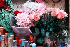 Minsk , Belarus - January 30, 2019. Festive table - flowers and bottles of alcohol. Minsk , Belarus - January 30, 2019. Photo of  Festive table - flowers and stock photos