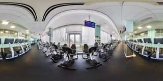 MINSK, BELARUS - JANUARY, 2017: Full spherical panorama 360 angle view Inside of interior of big stylish fitness club with sport royalty free stock photography