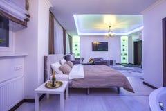 MINSK, BELARUS - January, 2019: luxure hall interior loft flat apartments in neon light stock image