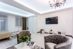 MINSK, BELARUS - January, 2019: luxure hall interior loft flat apartments with tv sofa and armchairs stock photography