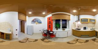 MINSK, BELARUS - JANUARY 19, 2013: Panorama in interior stylish kitchen in modern flat in chinese style. Full 360 degree seamless royalty free stock images