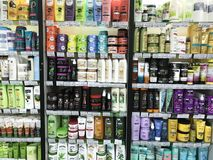Minsk, Belarus - January 13, 2018: Showcase of a supermarket with hair cosmetics from different manufacturers: shampoos. Masks, scrubs, paints, kondionion Royalty Free Stock Photography