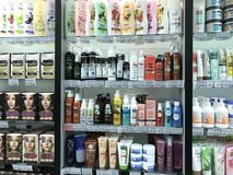 Minsk, Belarus - January 13, 2018: Showcase of a supermarket with hair cosmetics from different manufacturers: shampoos. Masks, scrubs, paints, kondionion Stock Photo