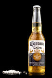 MINSK, BELARUS - JULY 10, 2017: Editorial photo of bottle of Corona Extra beer isolated on black, one of the top-selling beers wor. Ldwide is a pale lager royalty free stock photography