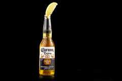 MINSK, BELARUS - JULY 10, 2017: Editorial photo of bottle of Corona Extra beer isolated on black, one of the top-selling. Beers worldwide is a pale lager Royalty Free Stock Photography