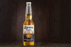 MINSK, BELARUS - JULY 10, 2017: Editorial photo of bottle of Corona Extra beer on wood background, one of the top. Selling beers worldwide is a pale lager Royalty Free Stock Photo