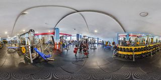 MINSK, BELARUS - JULY, 2017: full seamless panorama 360 by 180 angle view in interior of big stylish fitness club with sports royalty free stock photos
