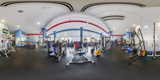 MINSK, BELARUS - JULY, 2017: full seamless panorama 360 by 180 angle view in interior of big stylish fitness club with sports stock photo