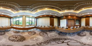 MINSK, BELARUS - JULY, 2017: full seamless panorama 360 by 180 angle view in interior of luxury empty conference hall for business royalty free stock photos
