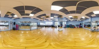 MINSK, BELARUS - JULY, 2017: full seamless panorama 360 angle view in interior of stylish fitness club gymnastics room and stock photography