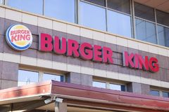 Minsk, Belarus - July 8, 2018: Inscription signboard burger king on the facade of the building in Minsk.  stock photos