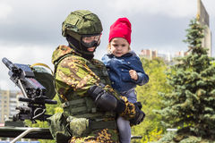 Minsk, Belarus - 03 July 2017 A military man holds a little girl in his arms, Independence Day. Royalty Free Stock Photography