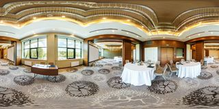 MINSK, BELARUS - JULY, 2017: panorama 360 angle view in interior of luxury empty conference hall for business meetings with. Banquet tables in equirectangular stock photo