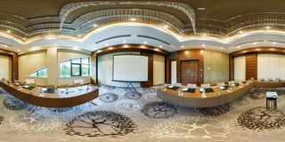 MINSK, BELARUS - JULY, 2017: panorama 360 angle view in interior of luxury empty conference hall for business meetings in. Equirectangular projection, skybox VR stock photography