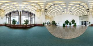 MINSK, BELARUS - JULY, 2016: panorama 360 angle view in interior of luxury empty hall with sofas and a beautiful huge chandelier royalty free stock photo
