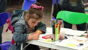 Minsk, Belarus, june 01, 2014: Children draw at a festival in a city park. Children`s Day. stock video footage