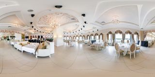MINSK, BELARUS - JUNE, 2015: Full spherical seamless panorama 360 degrees angle view in interior of stylish modern restaurant. Banqueting hall equirectangular stock photography