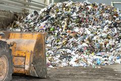 Minsk, Belarus -June 6, 2019 Pile of plastic bottles, paper and polyethylene at a waste recycling plant before sorting stock photo