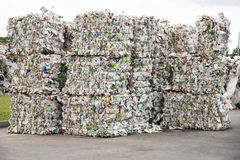 Minsk, Belarus -June 6, 2019Pile of pressed white plastic bottles at a garbage collection plant royalty free stock photos