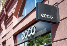 Minsk, Belarus - June 16, 2017: A sign ECCO above entrance to store in Minsk. Ecco is a Danish brand of shoes and footwear, spread royalty free stock images