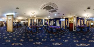 MINSK, BELARUS - MARCH 18, 2016: Panorama in interior luxury casino with croupiers girls. Full spherical 360 by 180 degrees royalty free stock photography