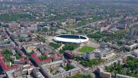 MINSK, BELARUS - MAY, 2019: Aerial drone shot view of city centre. Dinamo stadium and sports objects from above. MINSK, BELARUS - MAY, 2019: Aerial drone shot stock video