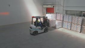 Minsk / Belarus - May 20 2019: Aerial Footage Forklift Trucks Loads and workers. stock footage