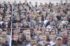 MINSK, BELARUS - MAY 23, 2018: Fans looks game during the Belarusian Premier League football match between FC Dynamo Minsk and FC royalty free stock photography