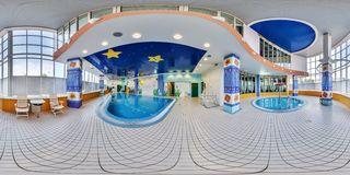MINSK, BELARUS - MAY, 2017: full seamless panorama 360 angle view in Interior of Children`s swimming pool with panoramic windows stock image