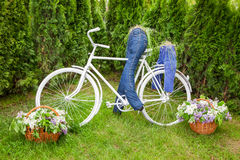 Minsk, Belarus, 23-May-2015: Garden composition - bike and cycli Royalty Free Stock Photos