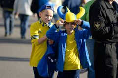 MINSK, BELARUS - MAY 23, 2018: Little fans having fun before the Belarusian Premier League football match between FC. Dynamo Minsk and FC Bate at the Tractor stock photos