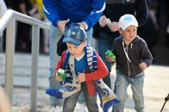 MINSK, BELARUS - MAY 23, 2018: Little fans having fun before the Belarusian Premier League football match between FC. Dynamo Minsk and FC Bate at the Tractor stock image