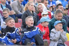 MINSK, BELARUS - MAY 23, 2018: Little fans having fun during the Belarusian Premier League football match between FC. Dynamo Minsk and FC Bate at the Tractor stock images