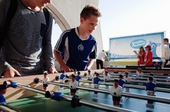 MINSK, BELARUS - MAY 23, 2018: Little fans plays table soccer before the Belarusian Premier League football match Royalty Free Stock Photography