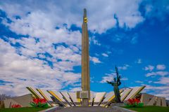 MINSK, BELARUS - MAY 01, 2018: Outdoor view of Stela, Minsk Hero city Obelisk, monument in Victory park. Bronze. Sculpture of woman, symbol of motherland royalty free stock photos