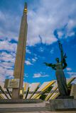 MINSK, BELARUS - MAY 01, 2018: Outdoor view of Stela, Minsk Hero city Obelisk, monument in Victory park. Bronze. Sculpture of woman, symbol of motherland royalty free stock photo