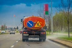 MINSK, BELARUS - MAY 01, 2018: Outdoor view of truck used for repair road and fix holes in the streets at the central. Street of independence Avenue prospect Royalty Free Stock Image