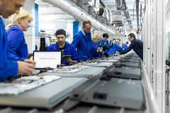 Minsk, Belarus - May 08, 2018: workshop for assembring televisions. Conveyor for the production of television sets. Testing TVs in the workshop. Electronics Royalty Free Stock Photos