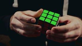 Minsk, Belarus - NOVEMBER 20, 2017: Boys hands solving Rubik`s Cube 3x3x3 stock footage