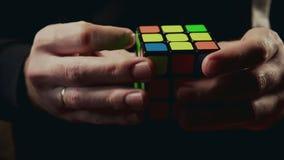 Minsk, Belarus - NOVEMBER 20, 2017: Boys hands solving Rubik`s Cube 3x3x3 stock video