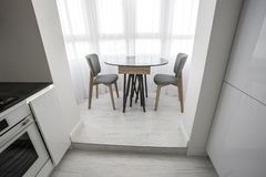 luxure hall interior loft flat in grey style design with chairs and table royalty free stock photos