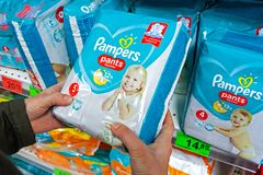 Free MINSK, BELARUS - October 4, 2019: Diapers `Pampers` In Hands In A Supermarket. Stock Photo - 160775400