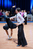 MINSK-BELARUS, OCTOBER 9:child Dance Couple. MINSK-BELARUS, OCTOBER 9: an Unidentified child Dance Couple performs Latin-American Program on The Style Open Cup Stock Photo