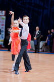 MINSK-BELARUS, OCTOBER 9:child Dance Couple. MINSK-BELARUS, OCTOBER 9: an Unidentified child Dance Couple performs Latin-American Program on The Style Open Cup Royalty Free Stock Photo
