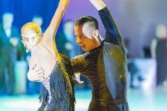 Minsk-Belarus, October 18, 2014: Egor Kosyakov-Anastasiya Belmac. H perform Adult Latin-American Program on on IDSA World Open Championship 2014 in October 18 Royalty Free Stock Images