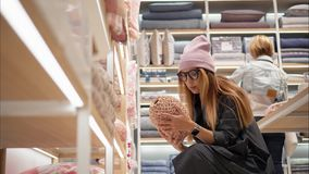 MINSK, BELARUS - OCTOBER 10, 2017. Inside Zara Home retail store in Minsk. A young hipster female in fashion glasses stock image