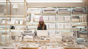 Minsk, Belarus - October 10, 2017. Inside Zara Home retail store in Minsk. A young hipster female in fashion glasses stock video footage